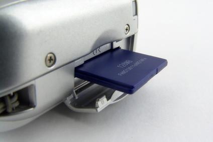 Cómo Obtener Adobe para abrir la hora de poner una tarjeta SD en la impresora para transferir fotografías