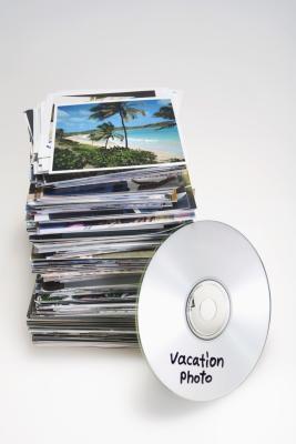 ¿Puedo poner fotos en discos y transferirlos a mi escritorio?