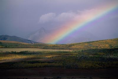 Cómo hacer que los colores del arco iris en una fotografía del soporte hacia fuera usando Photoshop